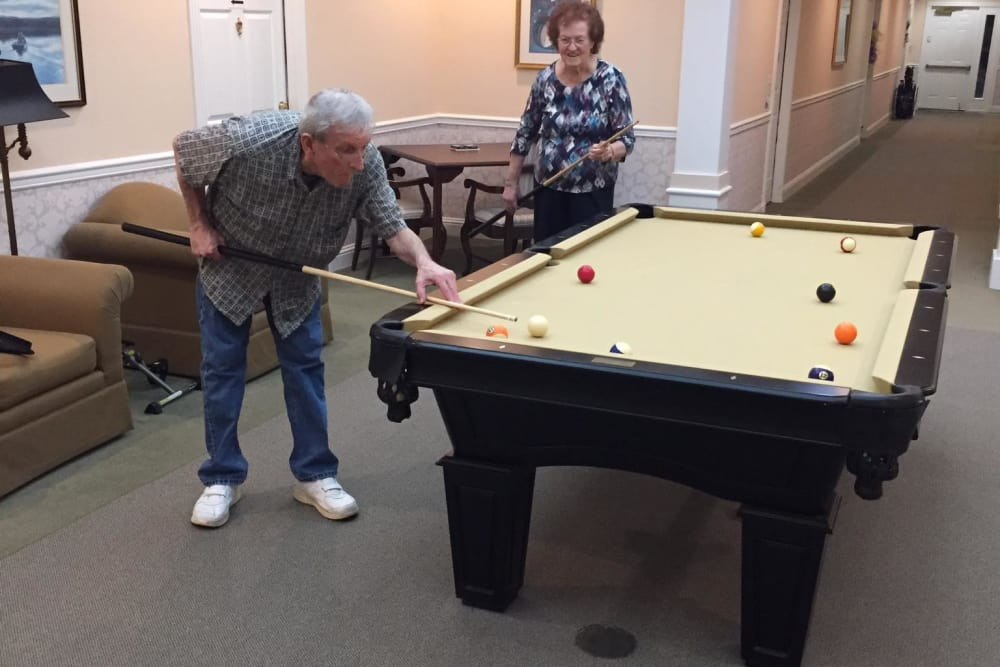 Senior man playing pool at Azalea Estates of Gonzales in Gonzales, LA.