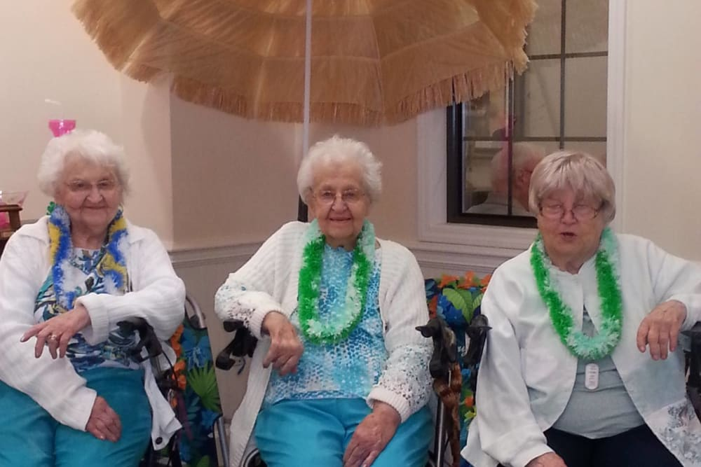 Residents under an umbrella at Tanglewood Trace in Mishawaka, Indiana
