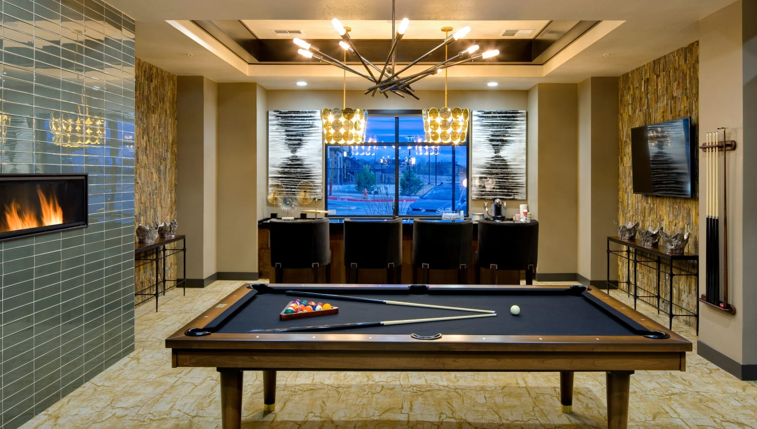 Community lounge with pool table and TV at Olympus Alameda in Albuquerque, New Mexico