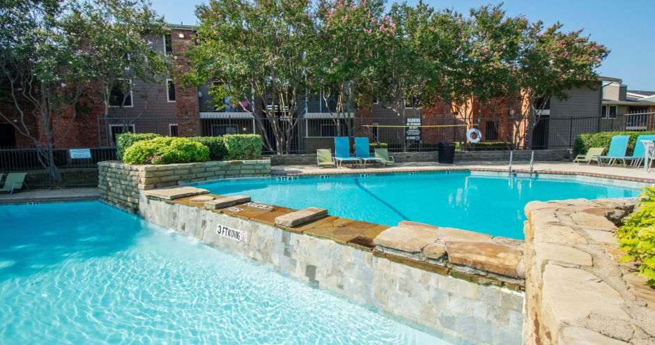 Beautiful swimming pool at apartments in Irving, TX