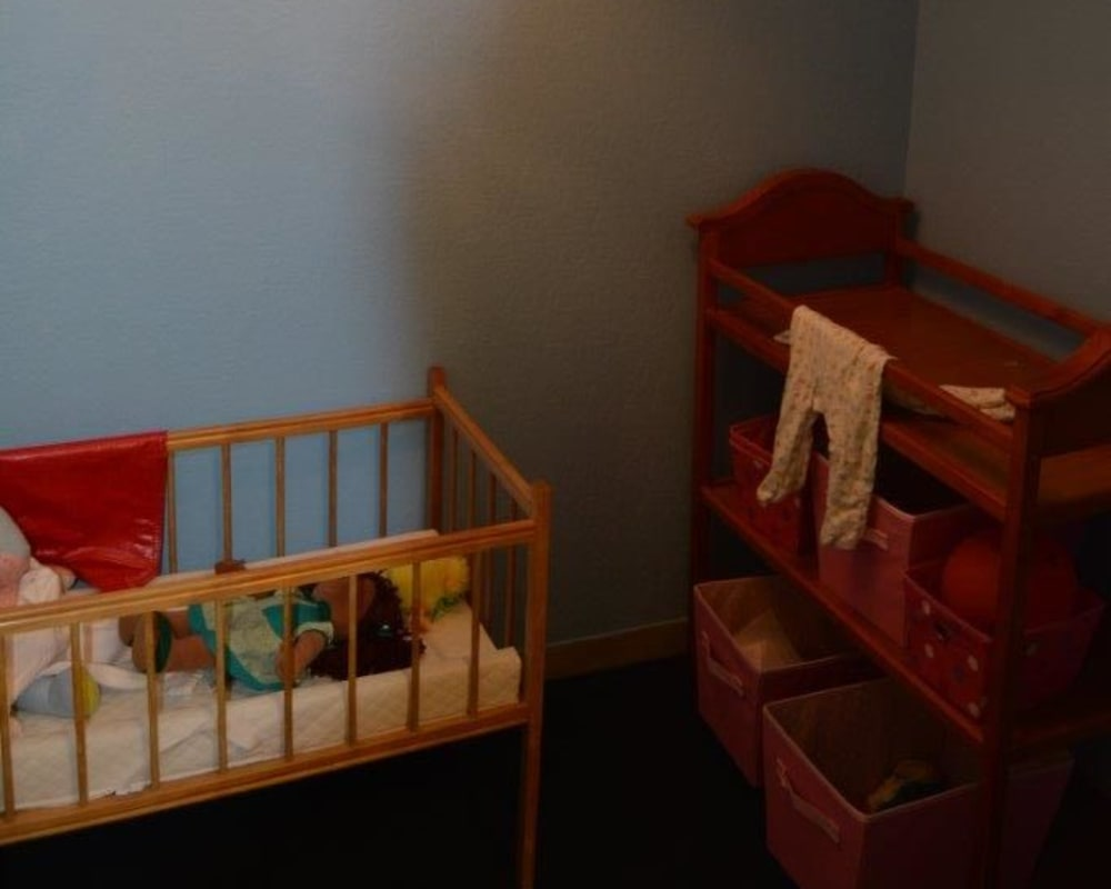 Memory station with dolls and furniture at Courtyard Estates at Hawthorne Crossing in Bondurant, Iowa.