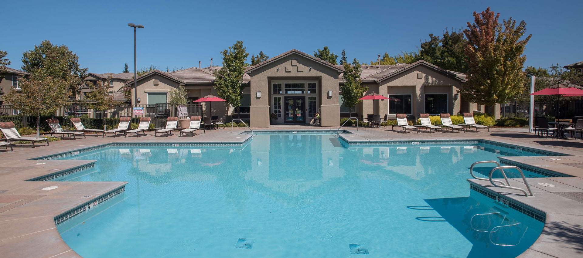 The Artisan Apartment Homes offers a spacious swimming pool in Sacramento, California
