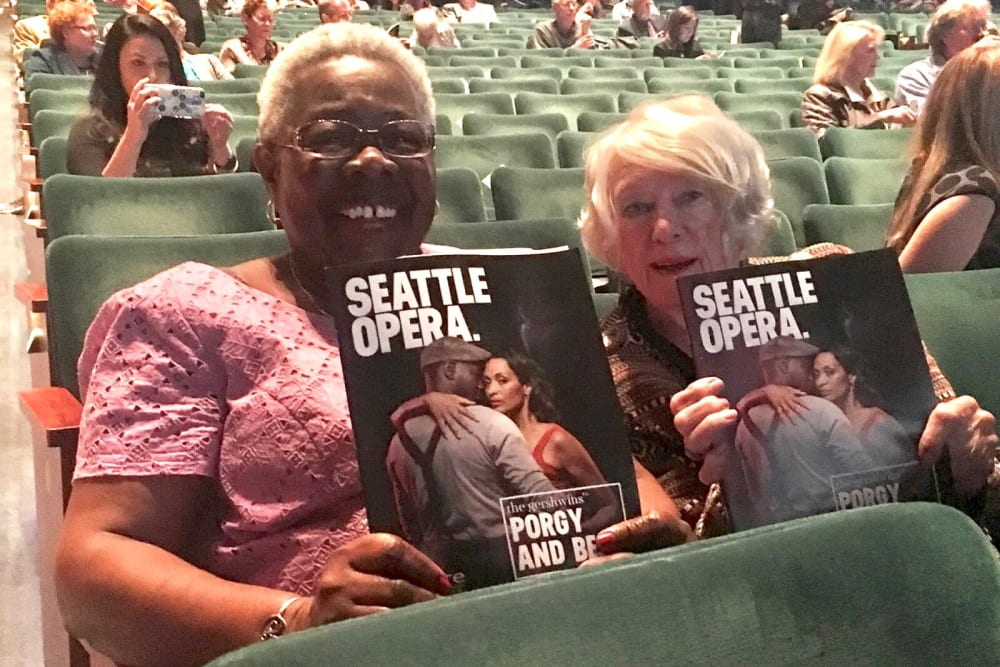 Two ladies having fun at the Seattle Opera near Merrill Gardens at First Hill in Seattle, Washington.