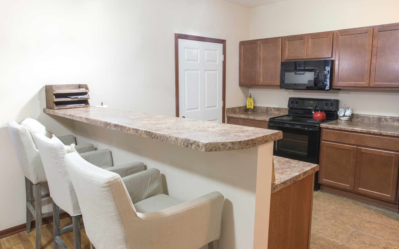 Apartment kitchen with bar seating at Woodland Reserve in Ankeny, Iowa