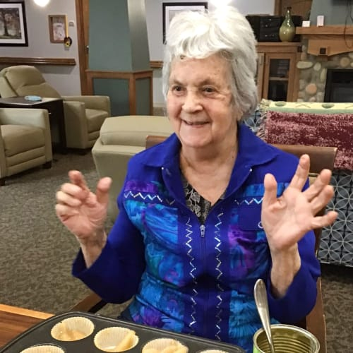 Resident making cupcakes at Glen Carr House Memory Care in Derby, Kansas