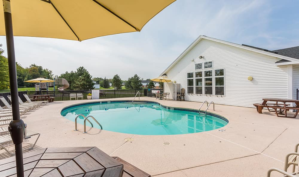Enjoy a swimming pool near Green Lake Apartments your home in Orchard Park, {llocation_state}}