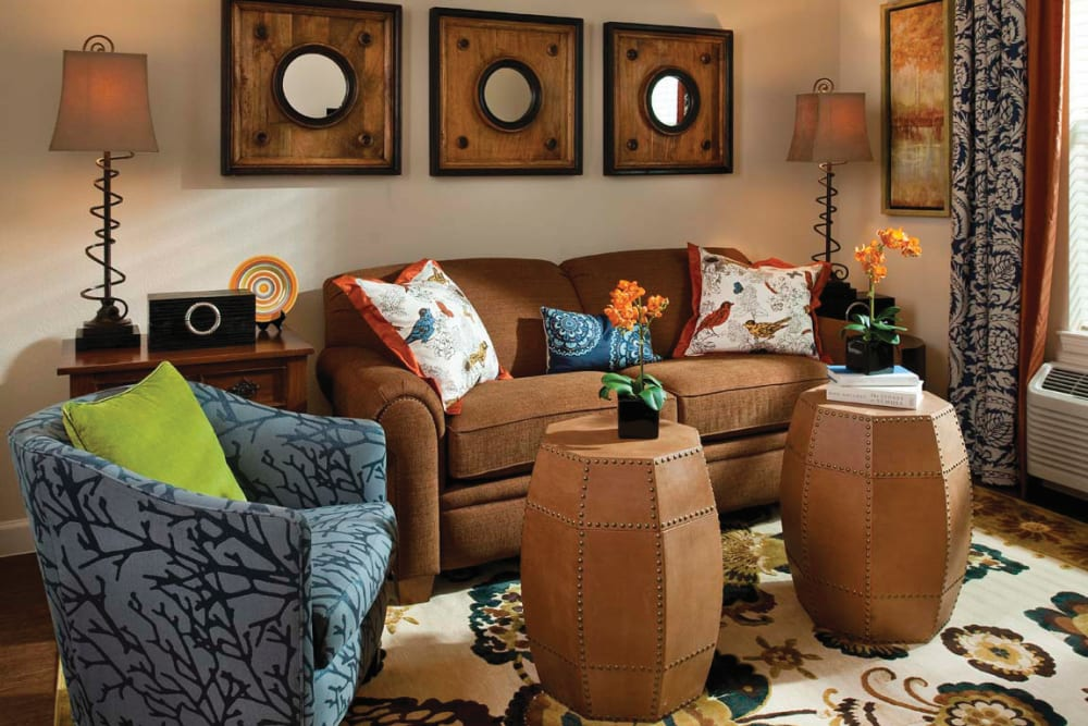 A couch and love seat in the living room of an apartment at Isle at Cedar Ridge in Cedar Park, Texas