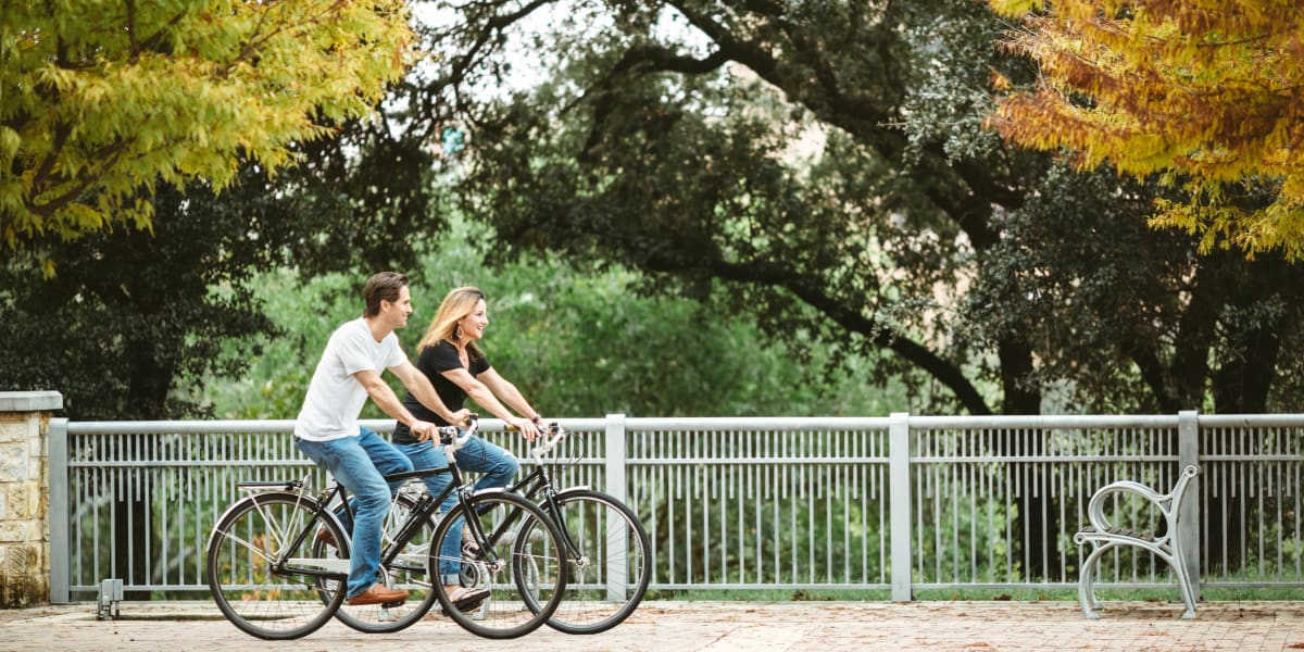 Residents biking in park in Katy, Texas near Marquis at the Reserve
