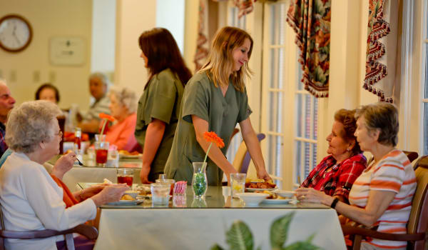 Residents enjoy dining together and being taken care of at Azalea Estates of New Iberia in New Iberia, LA.