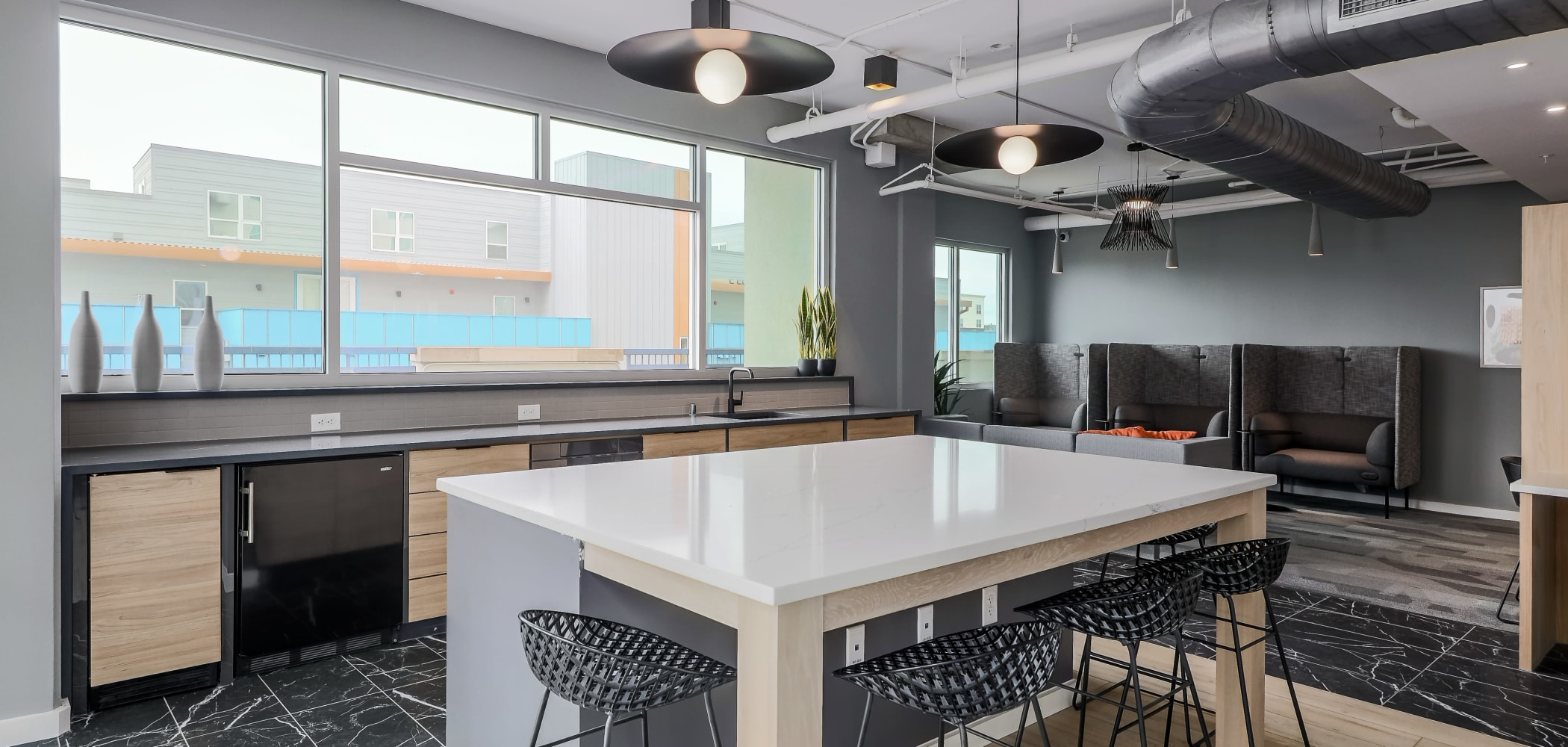 Study area with a kitchenette at 21 Rio in Austin, Texas
