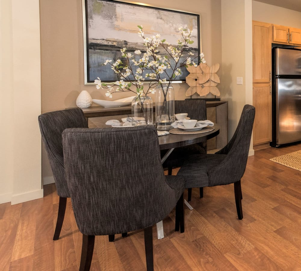 Dining room with wood-style flooring at Eddyline at Bridgeport in Portland, Oregon