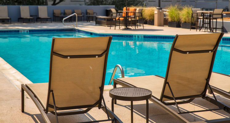 Sun chairs by the pool at Prospect Place in Hackensack, New Jersey
