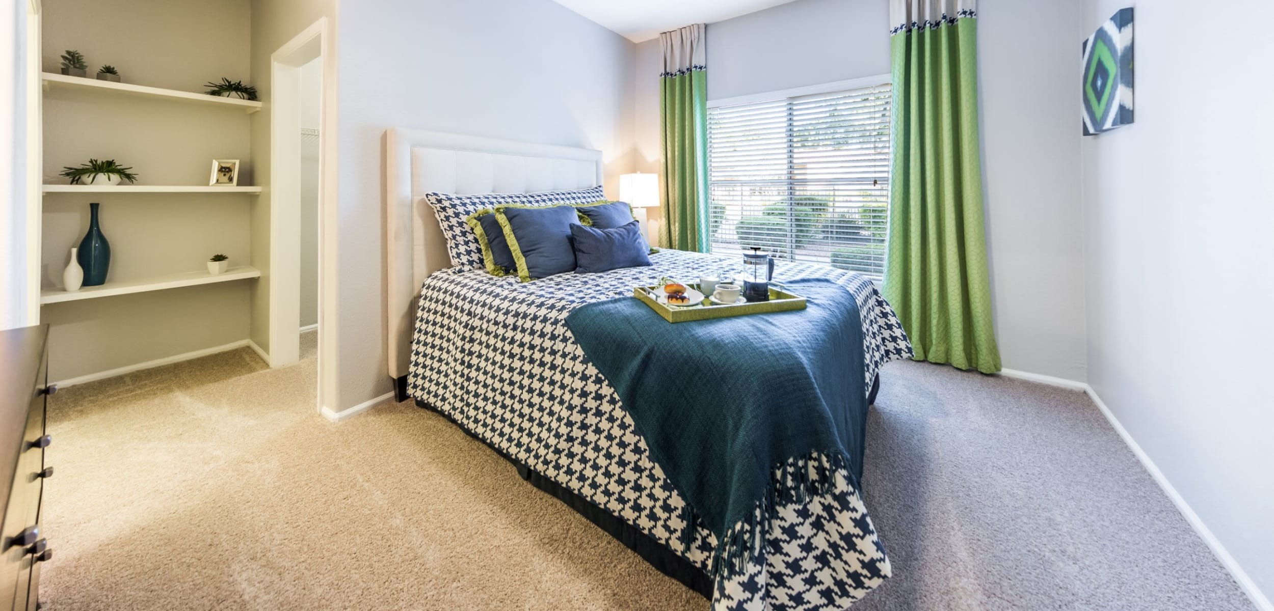 Bedroom with a large window at Marquis at Arrowhead in Peoria, Arizona
