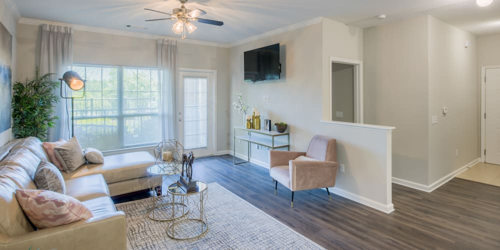 Open concept floor plan with hardwood floors and modern decor at The Vive in Kannapolis, North Carolina