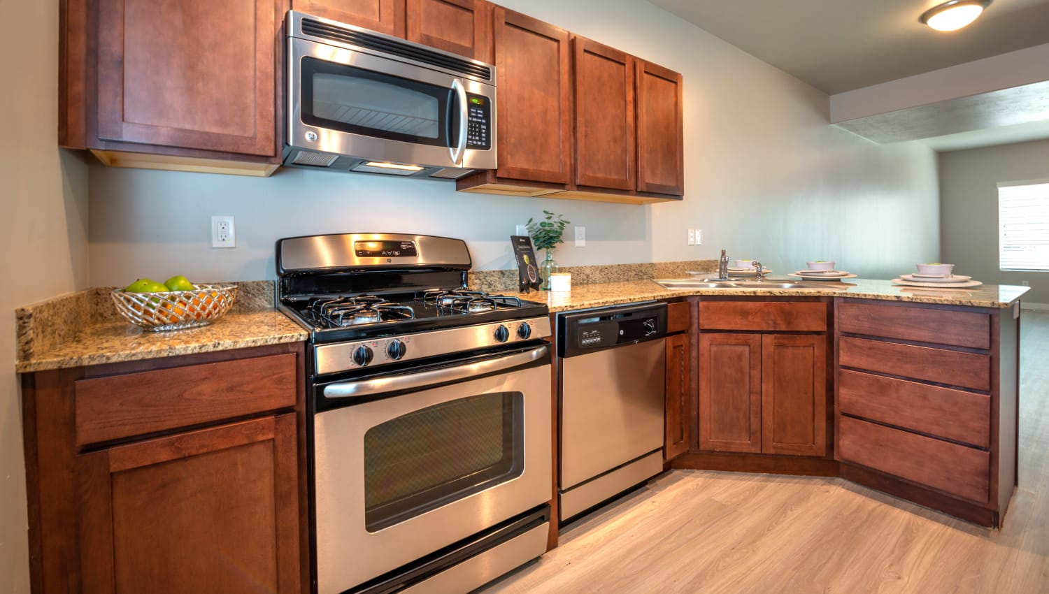 Kitchen with stainless steel appliances at Olympus at the District in South Jordan, Utah