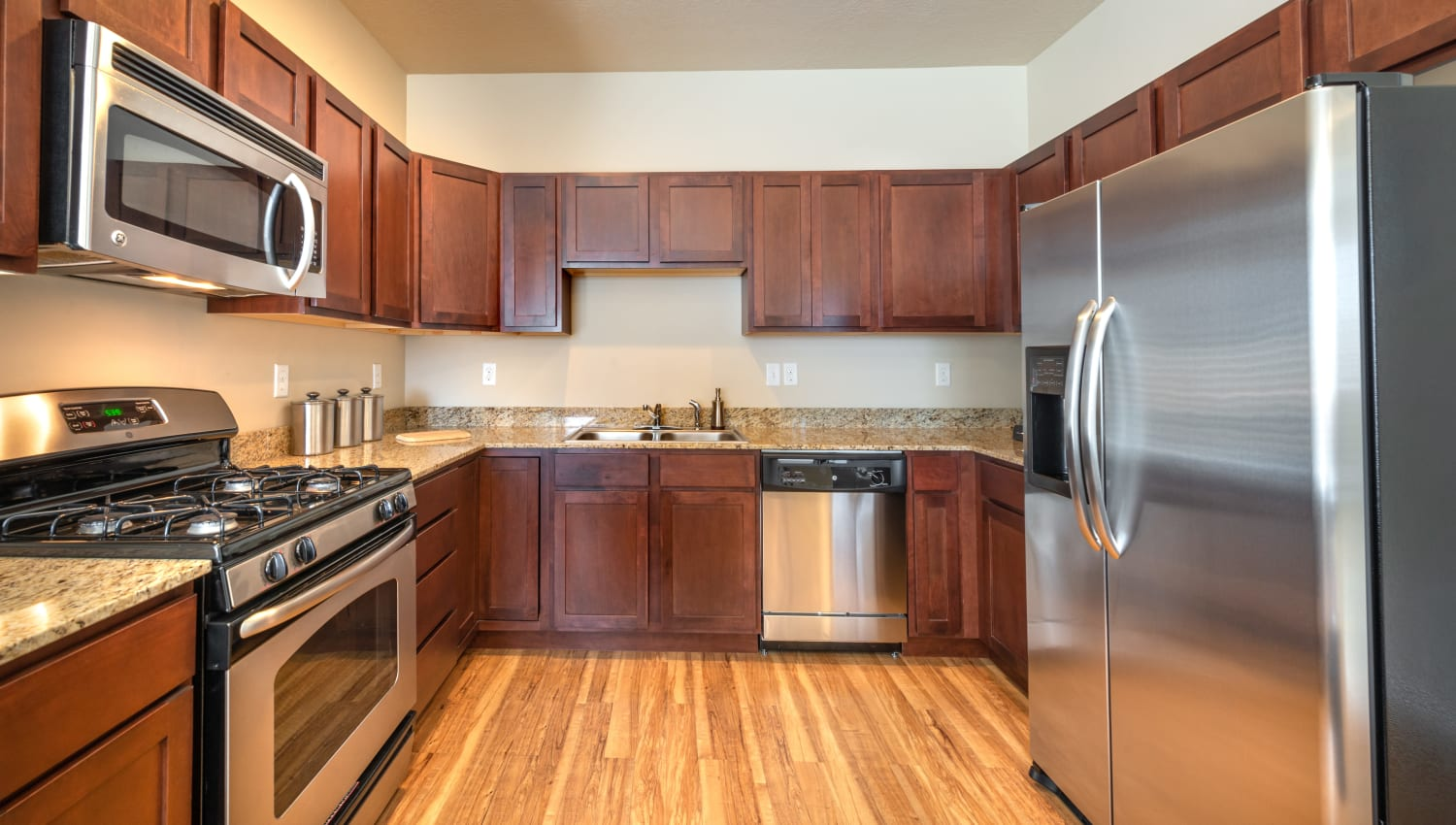 Spacious kitchen with stainless steel appliances and ample storage space