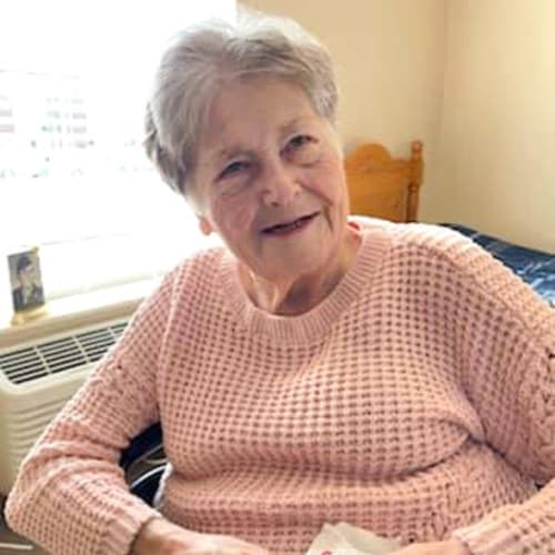 Resident seated in her apartment at Alderbrook Village in Arkansas City, Kansas
