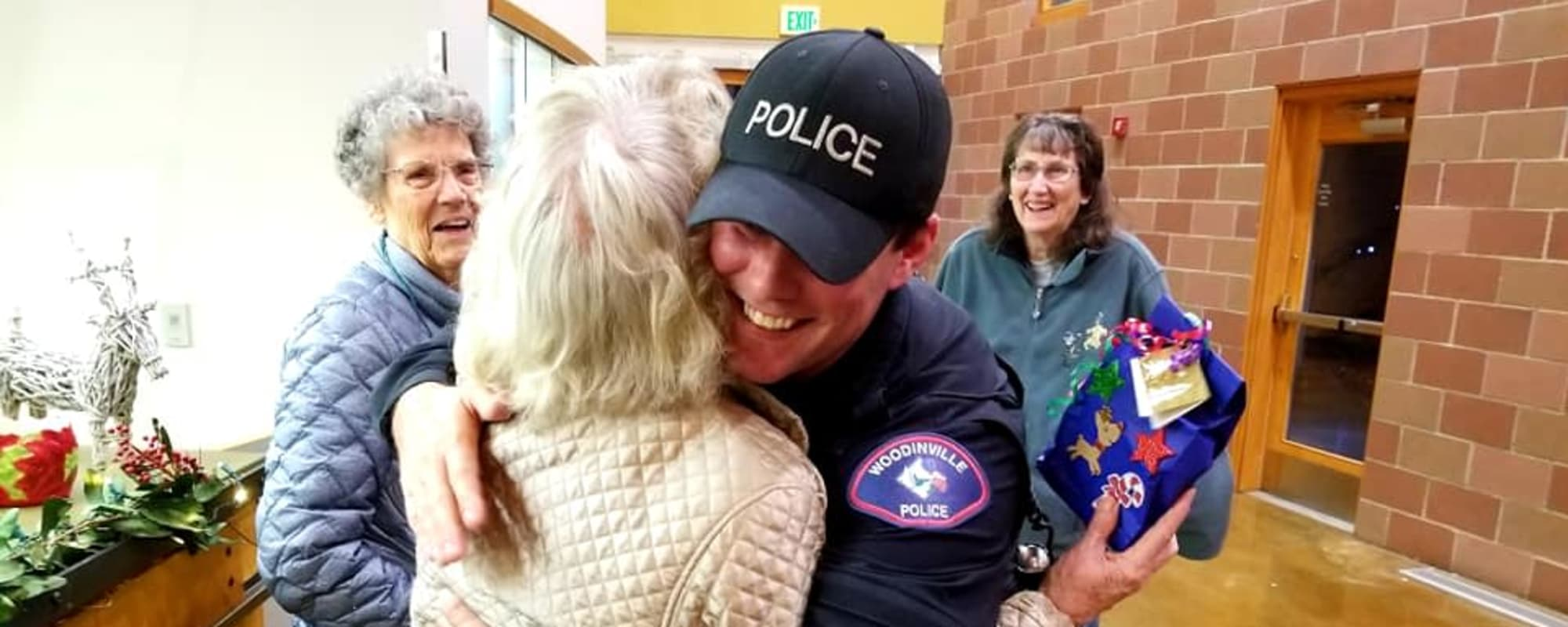 Police officer hugging a senior at The Creekside in Woodinville, Washington