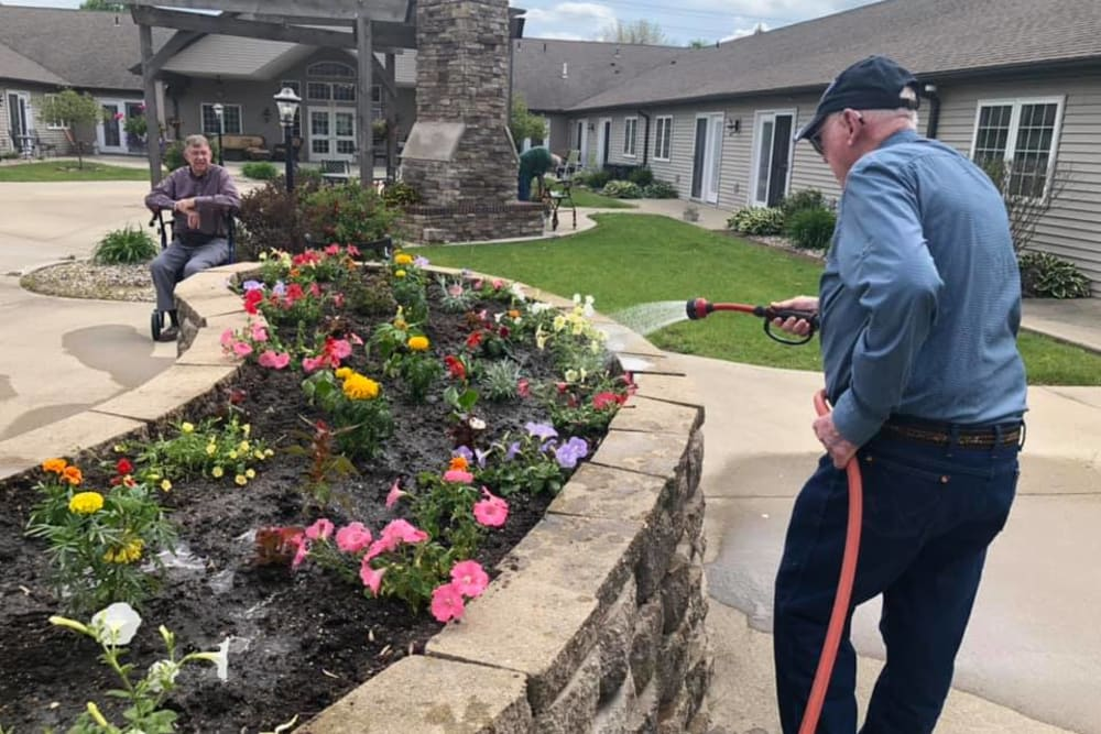 Residents gardening at Villas of Holly Brook Effingham in Effingham, Illinois