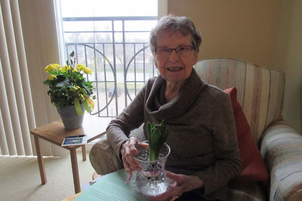 Resident with flowers at Aspired Living of Westmont