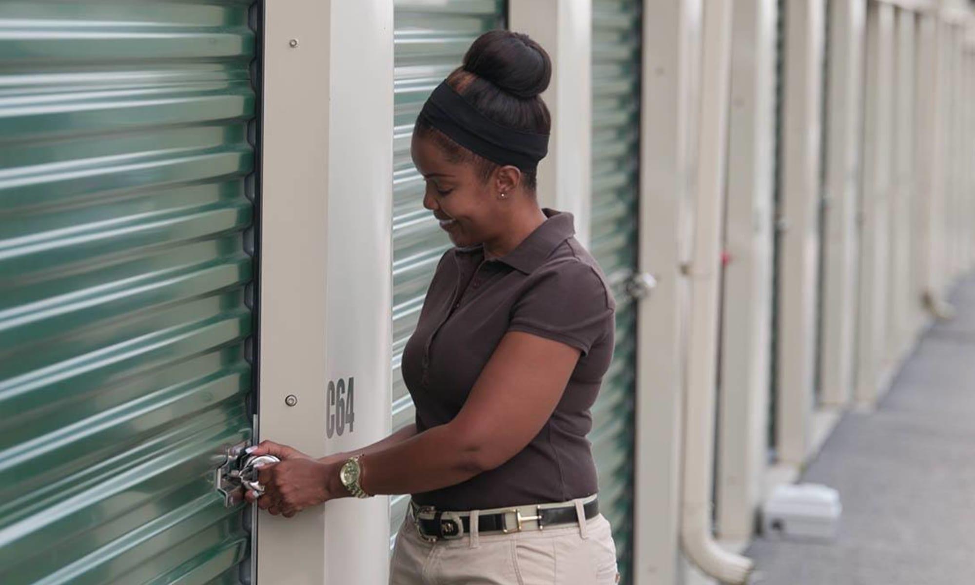 A customer secures her unit at Virginia Varsity Storage in Christiansburg, Virginia