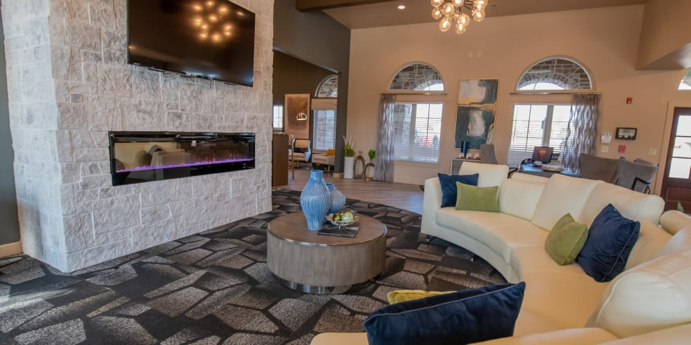 Clubhouse with LED fireplace  at Portico at Friars Creek Apartments in Temple, Texas