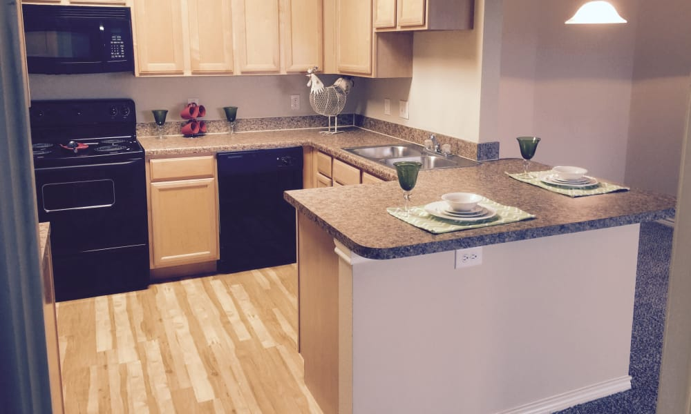 Fully equipped kitchen at Hillstone Ranch Apartments in San Antonio, Texas