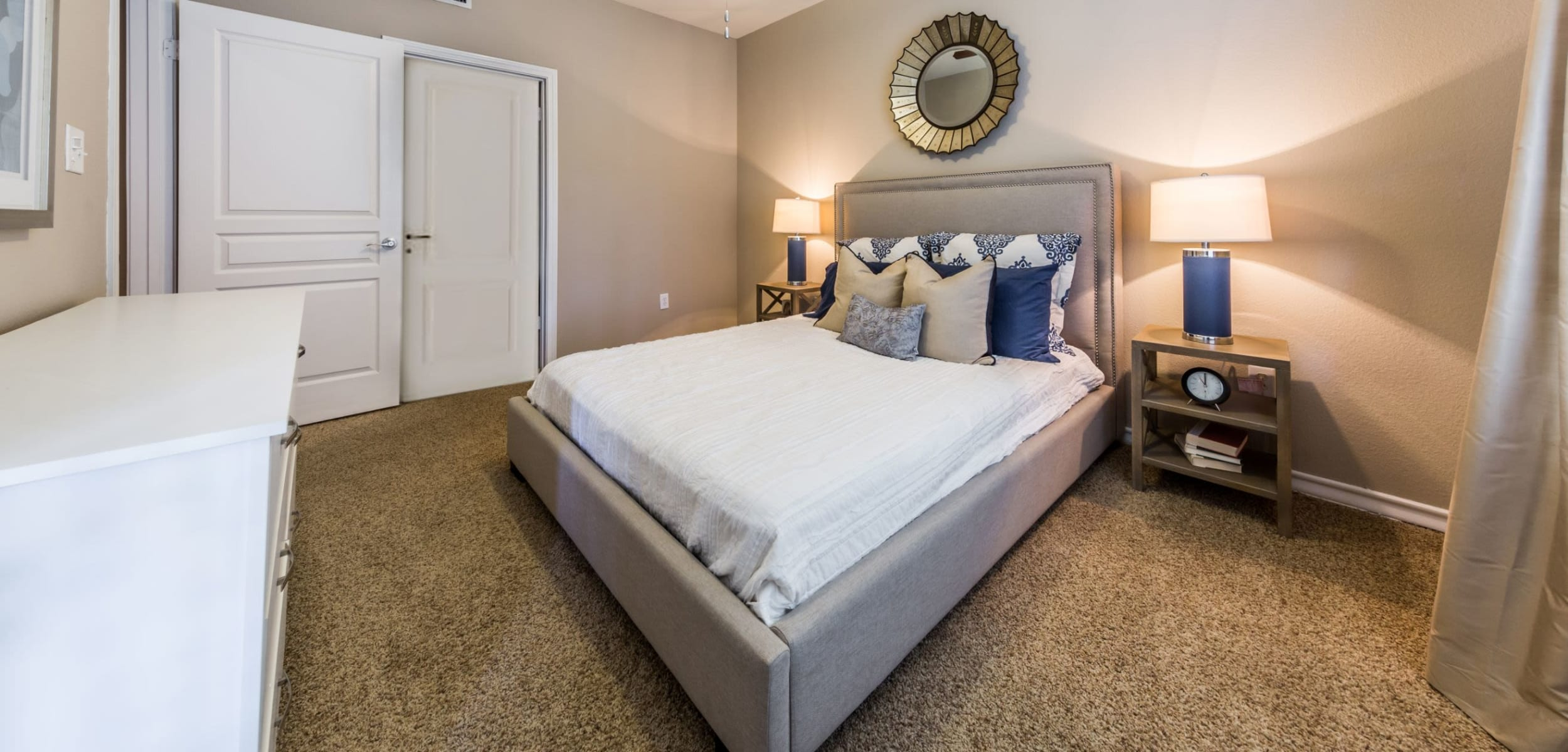 Bedroom with a ceiling fan at Marquis at Deerfield in San Antonio, Texas