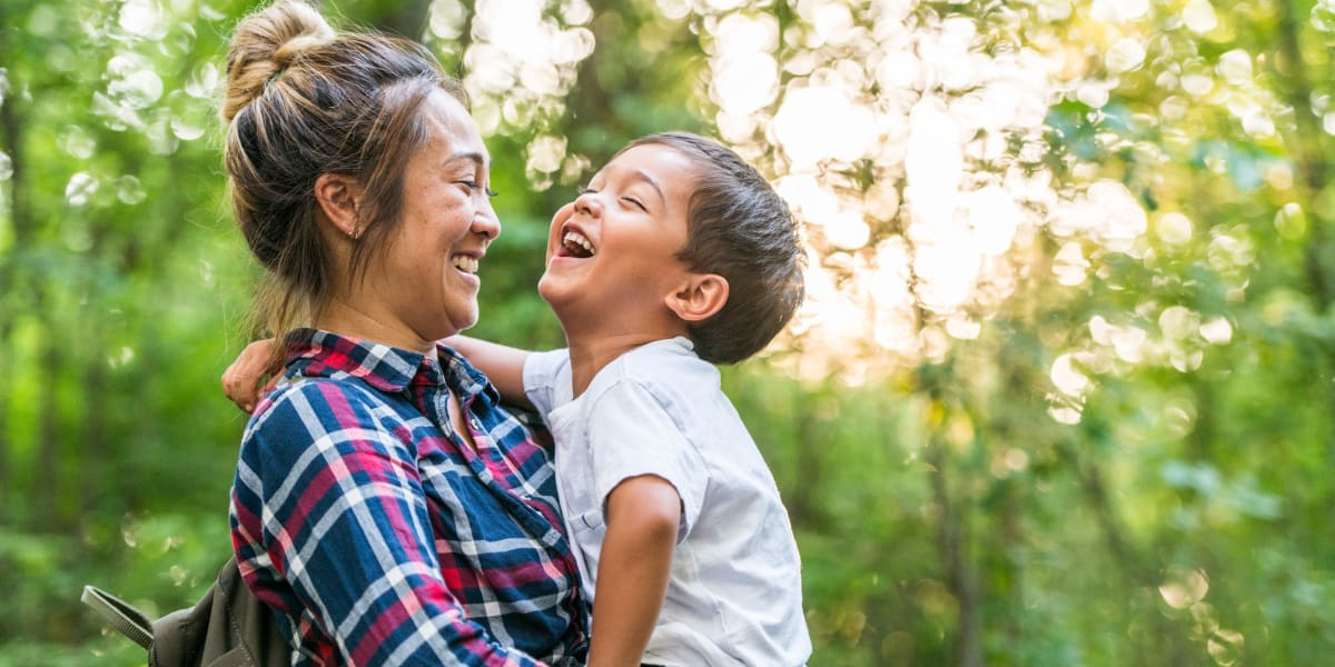 Resident laughing with her son while out hiking near Marquis at Stone Oak in San Antonio, Texas