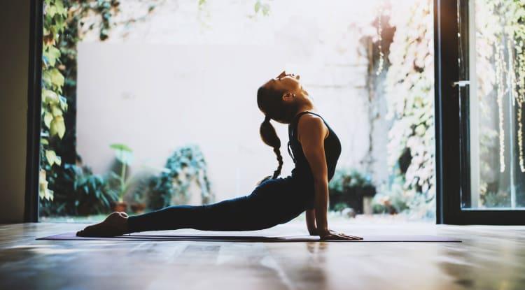 Woman doing yoga at YOO on the Park in Atlanta, Georgia