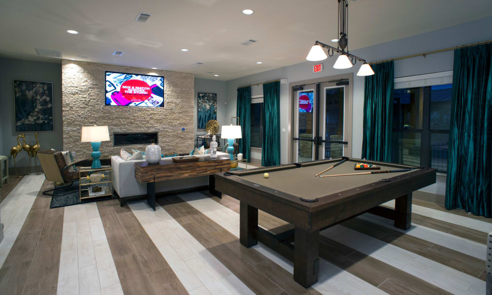 Resident clubhouse with pool table at Savannah Oaks in San Antonio, Texas