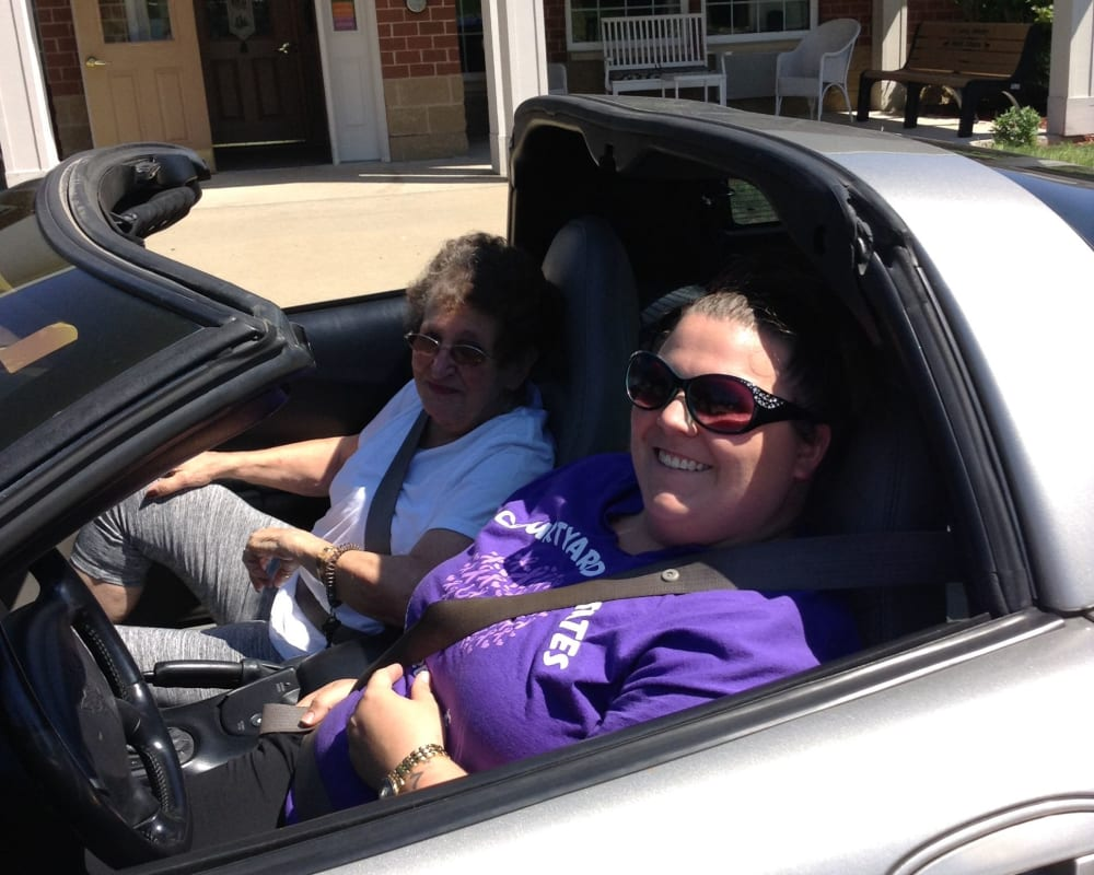 Resident Jan riding in a corvette for her Dare to Dream event Courtyard Estates at Cedar Pointe in Pleasant Hill, Iowa.
