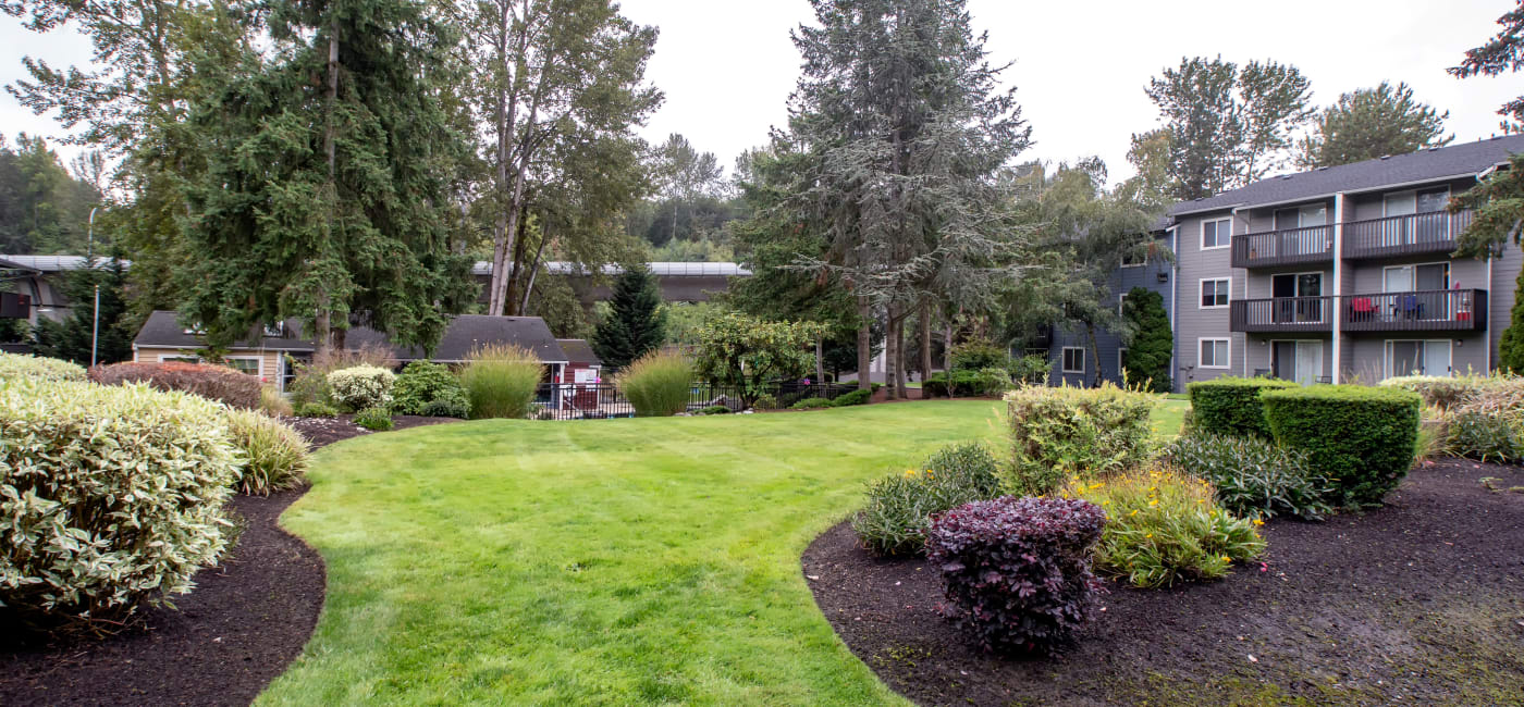 Beautifully maintained landscaping and green spaces at The Boulevard at South Station Apartment Homes in Tukwila, WA