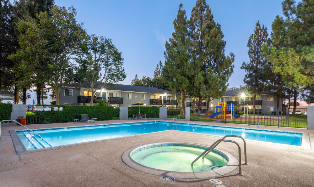 Outdoor pool and hot tub at Creekside Village Apartment Homes