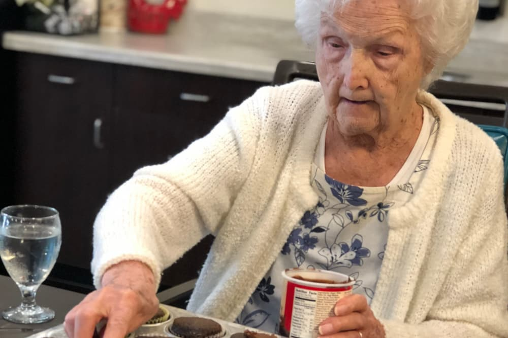 A resident frosting cupcakes at The Oaks at Northpointe in Zanesville, Ohio