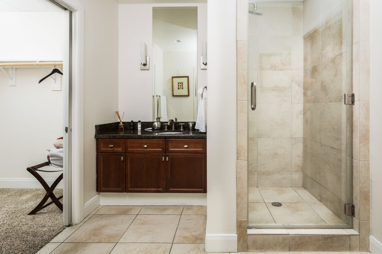 Modern bathroom with granite at The Heights at Park Lane in Dallas, Texas