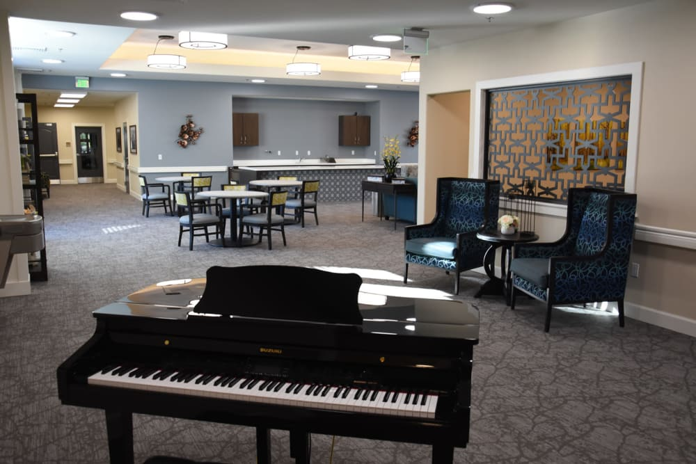 Baby Grand piano in community space at Shadow Mountain Memory Care in Phoenix, Arizona