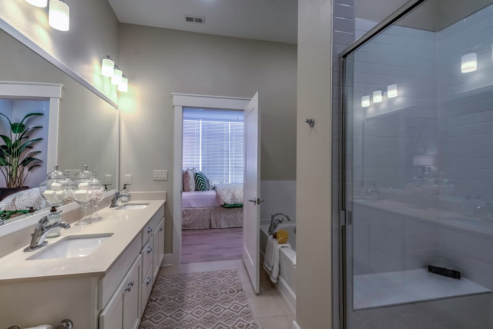 bathroom connected to bedroom at Carraway Village Apartments