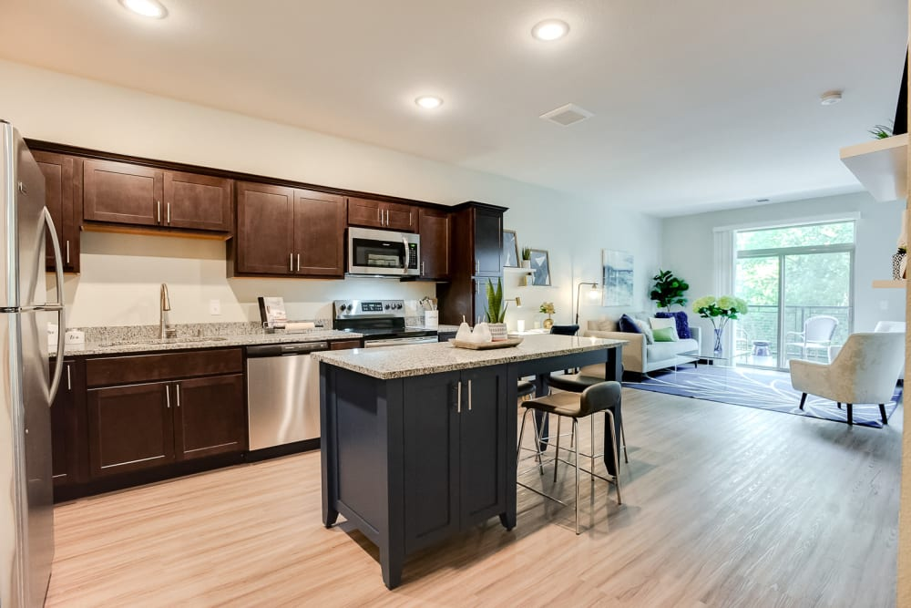 Open kitchen with plenty of cabinet space at Lake Jonathan Flats in Chaska, Minnesota