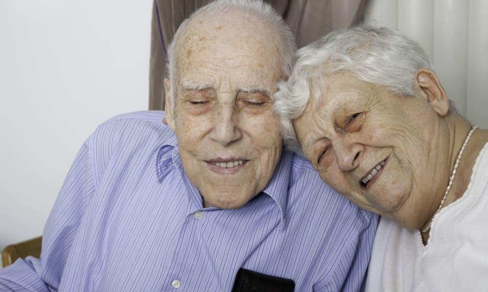 Senior couple smiling at The Colonial at Historic Camden in Camden, South Carolina