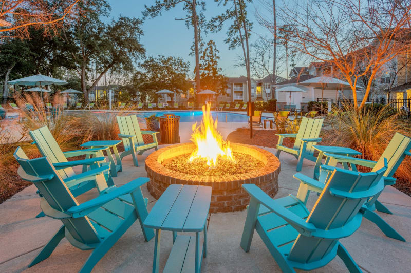 Outdoor fire pit with Adirondacks at Arbor Village in Summerville, South Carolina