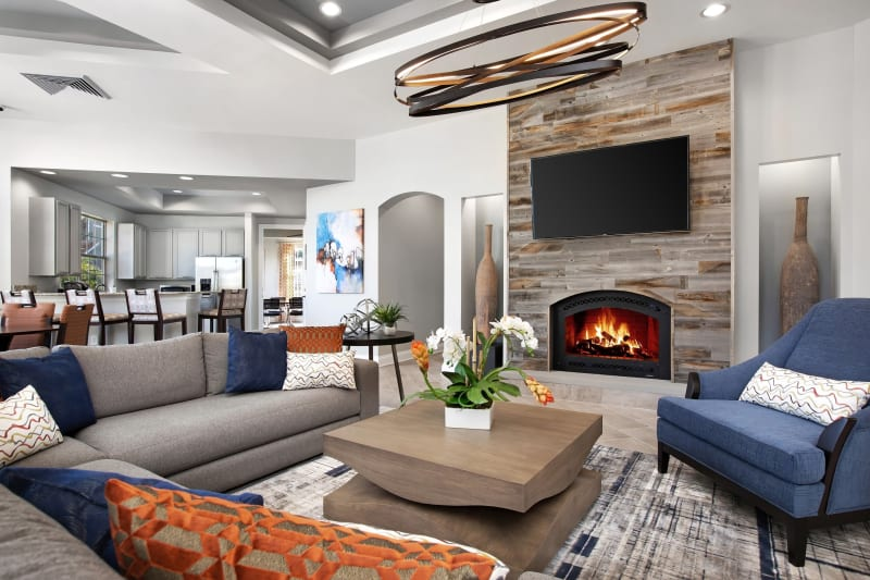Modern decor and fireplace in lobby at The Aspect in Kissimmee, Florida