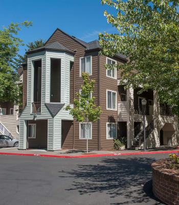 Beautiful exterior with large luscious trees at Waterhouse Place in Beaverton, Oregon
