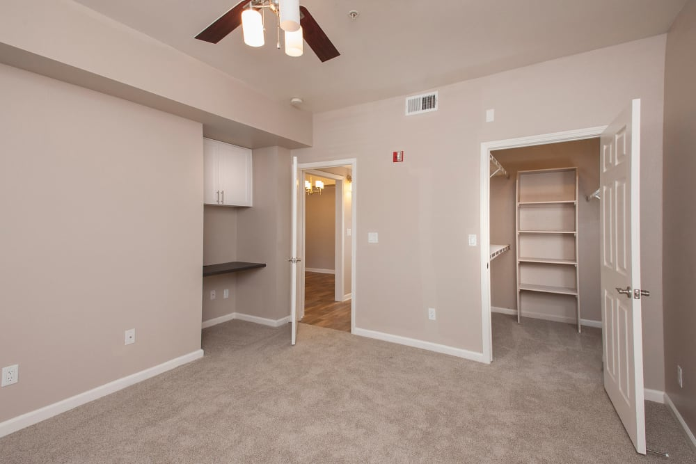 Spacious room with ceiling fan and walk-in closet at The Vintage at South Meadows Condominium Rentals in Reno, Nevada