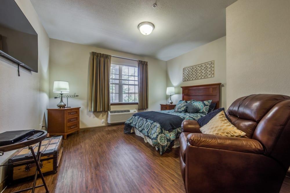 Resident bedroom with hardwood floors at The Landing at Stone Oak in San Antonio, Texas