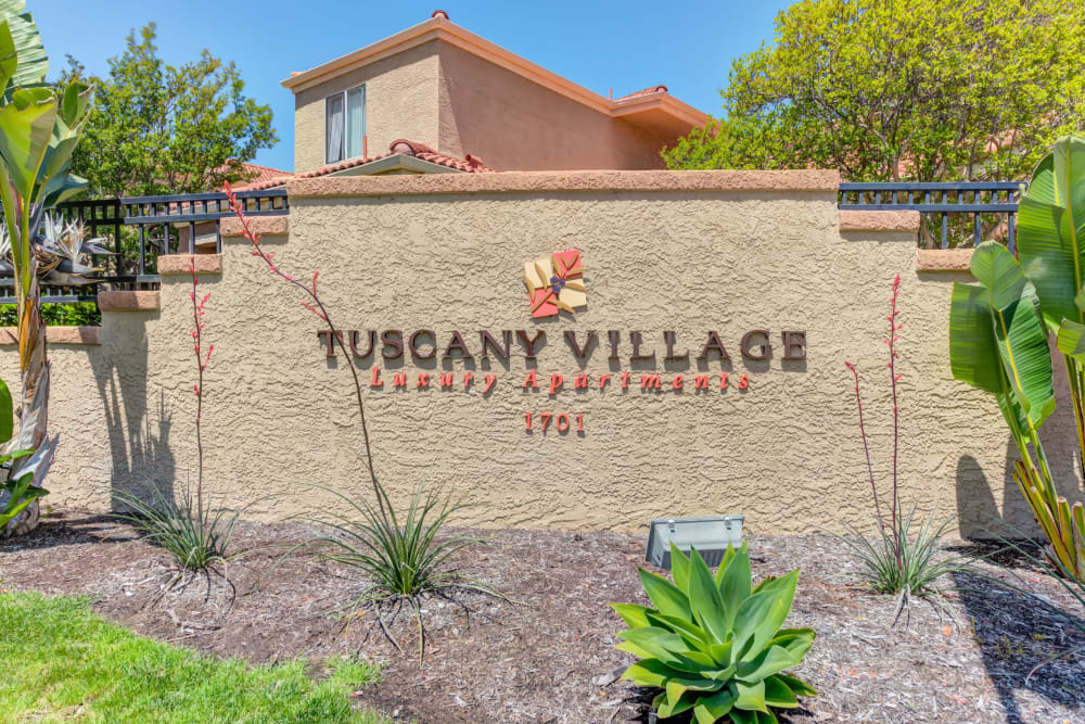 The front sign at Tuscany Village Apartments in Ontario, California