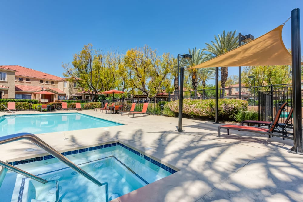 Beautiful resort-style swimming pool and hot tub at Tuscany Village Apartments in Ontario, California