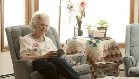 Senior reading at Meadow Ridge Senior Living