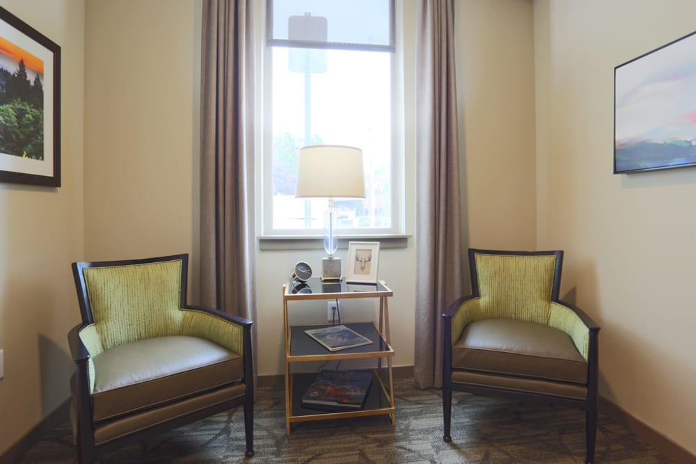 Resident reading nook in senior apartment at The Lofts at Glenwood Place in Vancouver, Washington