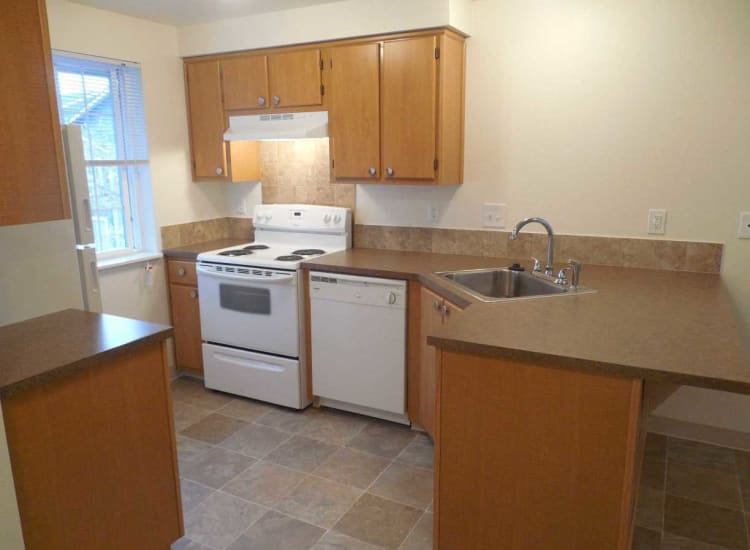 Well-lit kitchen at Conifer Place Apartments in Corvallis, Oregon